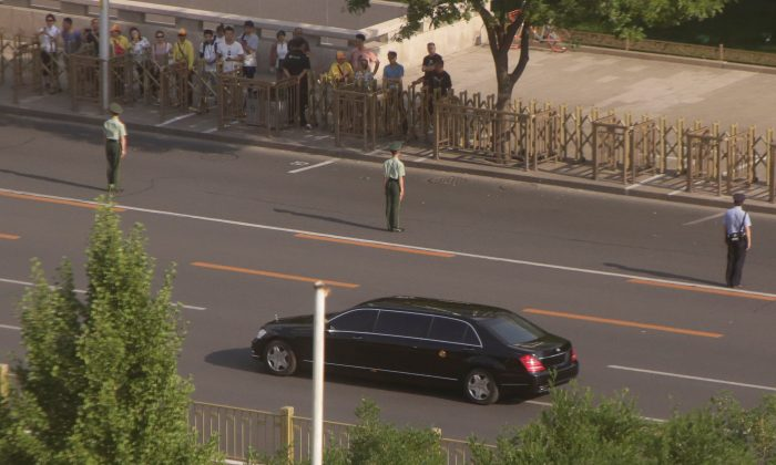 A vehicle of a motorcade believed to be carrying North Korean leader Kim Jong Un makes its way down Fuxingmennei Street in central Beijing, China, on June 19, 2018. (Jason Lee/Reuters)