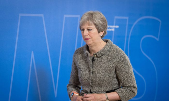 Prime Minister Theresa May finishes speaking following visiting patients at the Royal Free Hospital on June 18, 2018 in London, England. (Stefan Rousseau - WPA Pool/Getty Images)