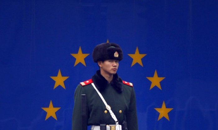 A paramilitary policeman stands guard at the entrance to the European Union embassy in Beijing on Dec. 13, 2011. (David Gray/Reuters)
