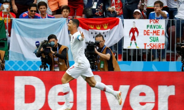 Soccer Football - World Cup - Group B - Portugal vs Morocco - Luzhniki Stadium, Moscow, Russia - June 20, 2018   Portugal's Cristiano Ronaldo celebrates scoring their first goal. (REUTERS/Kai Pfaffenbach)