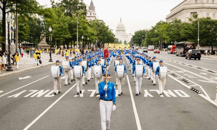 """The Tian Guo Marching Band heads down Pennsylvania Ave. in Washington on June 20, 2018. Tian Guo means """"celestial."""" (Edward Dye/Epoch Times)"""