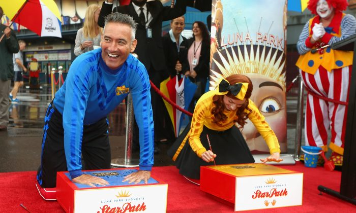 Blue Wiggle Anthony Field and Yellow Wiggle Emma Watkins cement their hands with the Wiggles as Luna Park Sydney on March 13, 2015.  (Cameron Spencer/Getty Images)