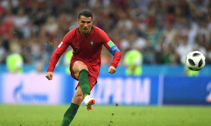 Cristiano Ronaldo scores a stunner of a free kick against Spain on June 15, 2018 in Sochi, Russia. (Stu Forster/Getty Images)