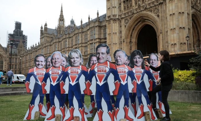 "Pressure Group Avaaz stage a Brexit vote protest urging 12 Tory rebels to be ""superheroes"" by voting to overturn government plans on June 20, 2018 in London, England. (Dan Kitwood/Getty Images)"