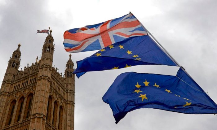 Union and European Union flags are flown in unison during an anti-Brexit demonstration outside the Houses of Parliament in London on June 20, 2018. (Niklas Halle'n/AFP/Getty Images)