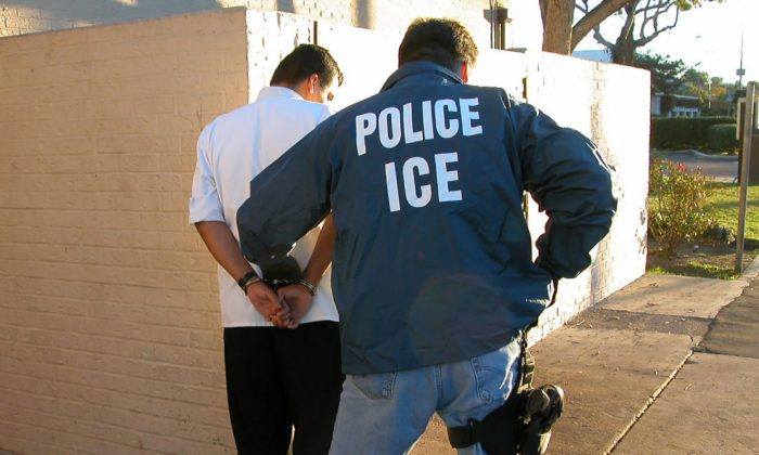 An Immigration and Customs Enforcement agent conducts an arrest. (ICE)