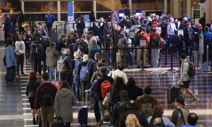 Travelers wait in line to go through the security area at Reagan National Airport in Arlington, Va., on Nov. 21, 2017. (Mark Wilson/Getty Images)