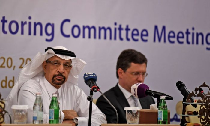 Saudi Energy Minister Khaled al-Faleh (L) and Russian Energy Minister Alexander Novak attend a meeting of OPEC and non-OPEC members to assess compliance with production cuts and to discuss potential long-term cooperation, in Jeddah, Saudi Arabia on April 20, 2018. (AMER HILABI/AFP/Getty Images)