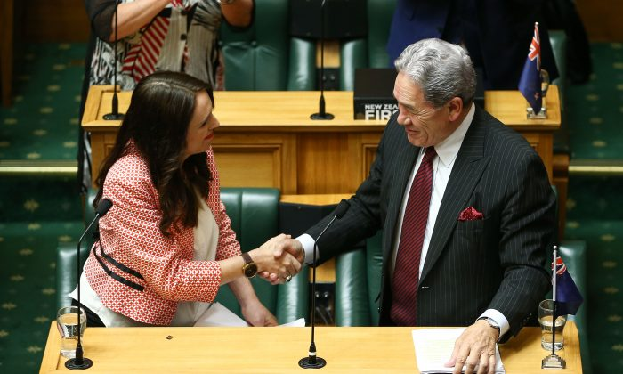 Prime Minister Jacinda Ardern shakes hands with Deputy Prime Minister Winston Peters after her speech during the 2018 budget presentation at Parliament on May 17, 2018 in Wellington, New Zealand. (Hagen Hopkins/Getty Images)