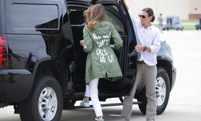First lady Melania Trump (C) climbs back into her motorcade after traveling to Texas to visit facilities that house and care for children taken from their parents at the U.S.-Mexico border at Joint Base Andrews, Maryland, on June 21, 2018. (Chip Somodevilla/Getty Images)