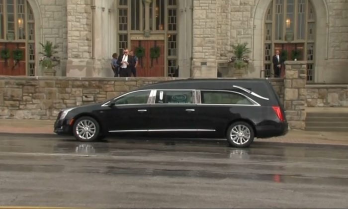 The hearse parked at the church of Kate Spade's funeral on 21 June 2018. (Reuters)