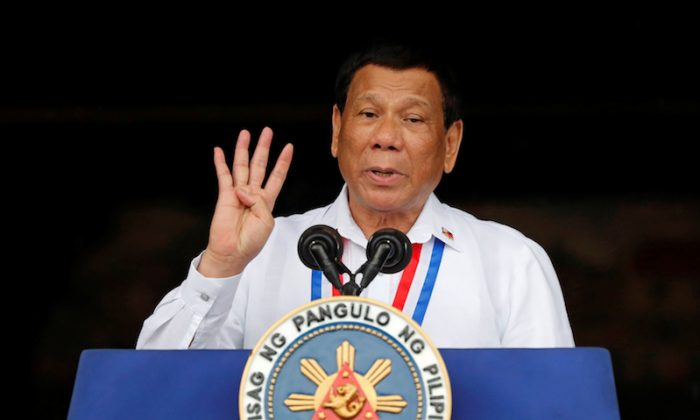 Philippine's President Rodrigo Duterte speaks during the 120th Philippine Independence day celebration at the Emilio Aguinaldo shrine in Kawit, Cavite Philippines June 12, 2018. (REUTERS/Erik De Castro)