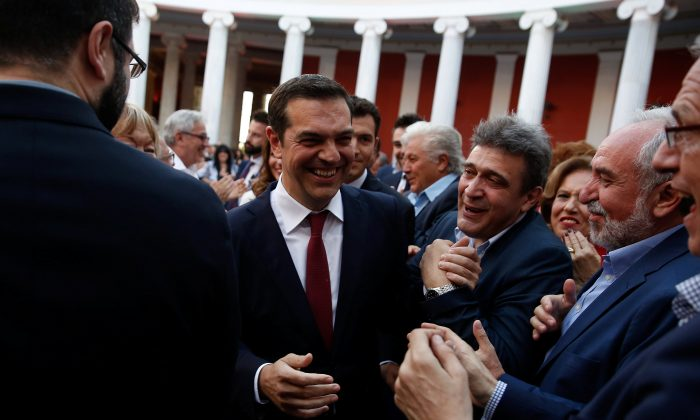 Greek Prime Minister Alexis Tsipras, is pictured wearing a tie for the first time in years in Athens, Greece on June 22, 2018. He had previously promised not to ear a tie until the debt crisis was resolved. (Reuters/Costas Baltas)