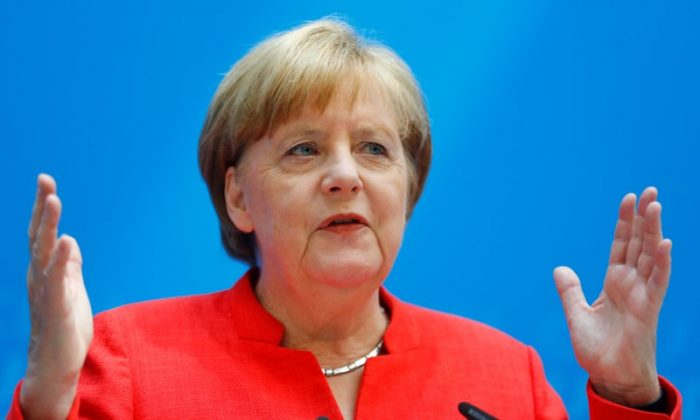 German Chancellor Angela Merkel gestures as she attends a press conference after the board meeting of Germany's Christian Democratic Union (CDU) in Berlin, Germany, June 18, 2018. (Reuters/Hannibal Hanschke)