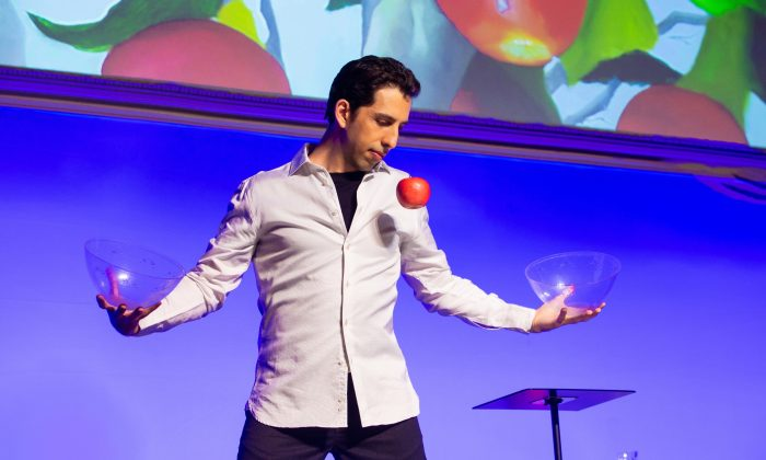 """Illusionist Vitaly Beckman makes and apple float without wires in his show """"Vitaly: An Evening of Wonders."""" (Jeremy Daniel)"""""""