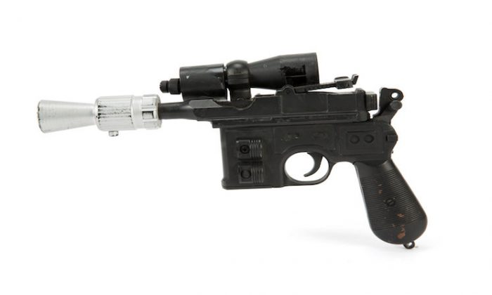 """The BlasTech DL-44 blaster used by Han Solo, played by Harrison Ford, from the Star Wars trilogy film """"Return of the Jedi."""" (Julien's Auctions/Handout via REUTERS)"""
