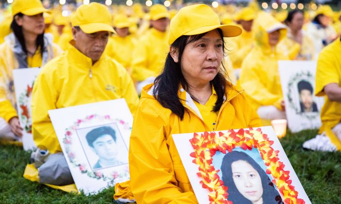 Gao Weiwei holds a picture of her sister, Gao Rongrong, who was killed in communist China for her belief in Falun Gong, in Washington on June 22, 2018. (Samira Bouaou/The Epoch Times)