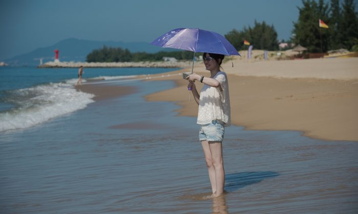 A woman enjoys the beach at the Club med resort in Sanya, Hainan Province, China, in this file photo. (Nicolas Asfouri/AFP/Getty Images)