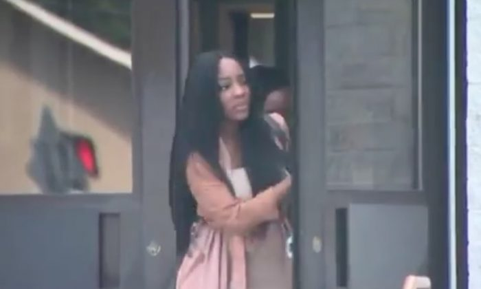 Faith Rodgers leaving the Suffolk County Police Department on Long Island on June 21, 2018. (Screenshot/Pix 11)