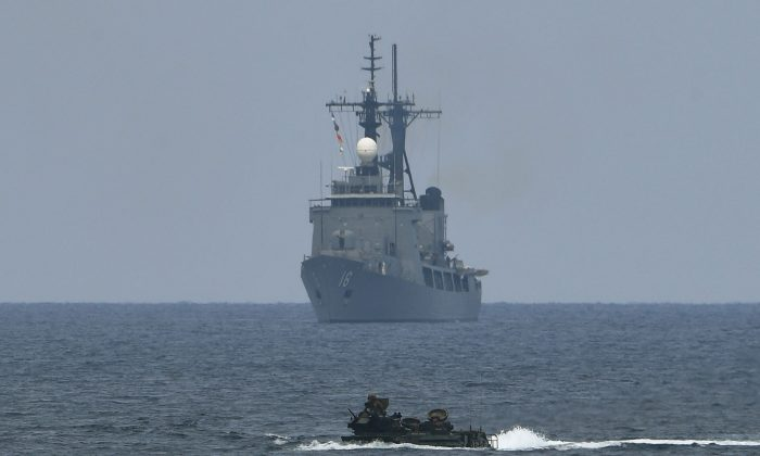 A U.S. assault amphibious vehicle with a Philippine navy frigate, Ramon Alcaraz, during annual Philippines and US joint military exercises in the South China Sea on May 9, 2018. (Ted Aljibe/AFP/Getty Images)