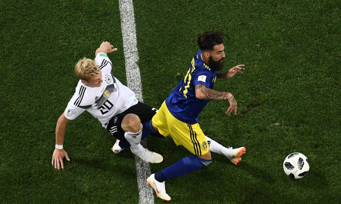 Germany's forward Julian Brandt (L) vies for the ball with Sweden's midfielder Jimmy Durmaz during the Russia 2018 World Cup match between Germany and Sweden  in Sochi on June 23, 2018. (Jewel Samad/AFP/Getty Images)