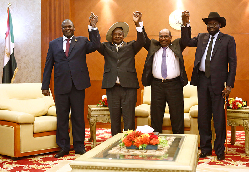 (L-R) South Sudan's opposition leader Riek Machar, Ugandan President Yoweri Museveni, Sudanese President Omar al-Bashir and South Sudanese President Salva Kiir, pose for a group picture before their meeting in Khartoum on June 25, 2018. (Ashraf Shazly/AFP/Getty Images)