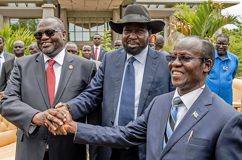 The Deal That Didn't Last: (L-R) First Vice President of South Sudan and former rebel leader Riek Machar, South Sudan President Salva Kiir and Second Vice President of South Sudan James Wani Igga shake hands after the formation of the new cabinet of the Transitional Government at the Cabinet Affairs Ministry in Juba on April 29, 2016. (Charles Lomodong/AFP/Getty Images)