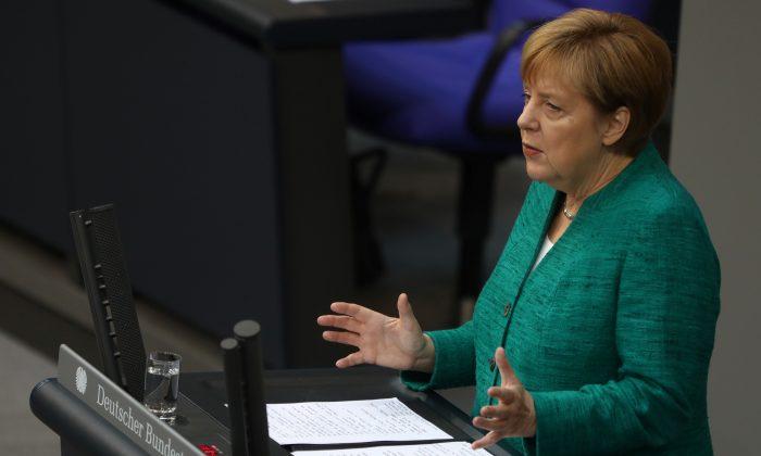 German Chancellor Angela Merkel addresses the German lower house of parliament Bundestag in Berlin, Germany, June 28, 2018. (Reuters/Christian Mang)
