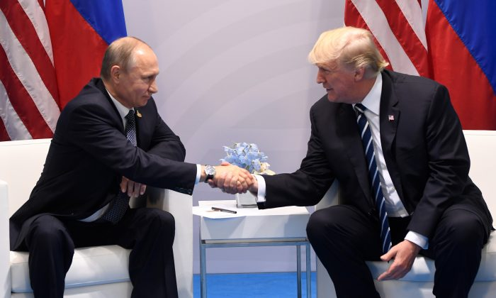U.S. President Donald Trump and Russia's President Vladimir Putin shake hands during a meeting on the sidelines of the G20 Summit in Hamburg, Germany, on July 7, 2017. (Saul Loeb/AFP/Getty Images)