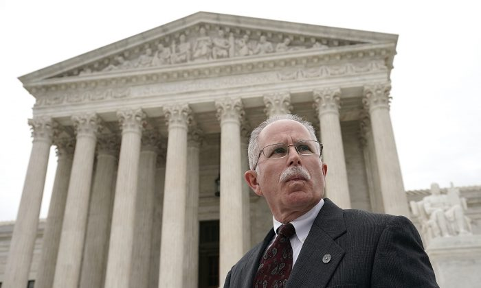 Plaintiff Mark Janus passes in front of the U.S. Supreme Court after a hearing in Washington on Feb. 26, 2018. Plaintiffs in California and Washington are seeking to expand the Supreme Court's ruling in his challenge to compulsory union dues. (Alex Wong/Getty Images)