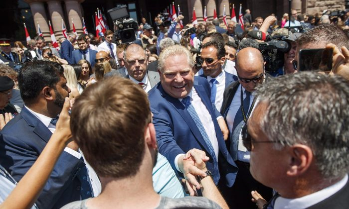 Doug Ford greets people after he is sworn in as premier of Ontario during a ceremony at Queen's Park in Toronto on Friday, June 29, 2018. THE CANADIAN PRESS/Mark Blinch
