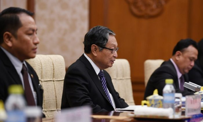 Burma's Minister of the Office of the State Counsellor Kyaw Tint Swe (C) speaks during a meeting with Chinese Foreign Minister Wang Yi (not seen) at the Diaoyutai State Guesthouse in Beijing, China on June 28, 2018. (Greg Baker/Reuters)