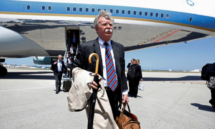 White House National Security Advisor John Bolton steps from Air Force One upon U.S. President Donald Trump's arrival in West Palm Beach, Florida, U.S., April 16, 2018.  (REUTERS/Kevin Lamarque/File Photo)