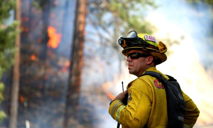 Todd Abercrombie, of Cal Fire watches the fire behavior as firefighters monitor fire movement as it crosses Highway 299 just west of Buckhorn Summit near the Trinity County line. (Kelly Jordan via USA Today Network)