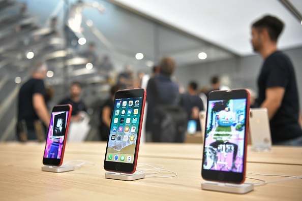 IPhones are on display at a new Apple Store Liberty, the first Italian flagship store of Apple in Milan, on July 26, 2018. (PIERO CRUCIATTI/AFP/Getty Images)