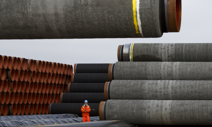 Pipes are loaded for stacking at the Nord Stream 2 facility at Mukran on Ruegen Islandon in Sassnitz, Germany, on Oct. 19, 2017. Nord Stream is laying a second pair of offshore pipelines in the Baltic Sea between Vyborg in Russia and Greifswald in Germany for the transportation of Russian natural gas to western Europe. (Carsten Koall/Getty Images)