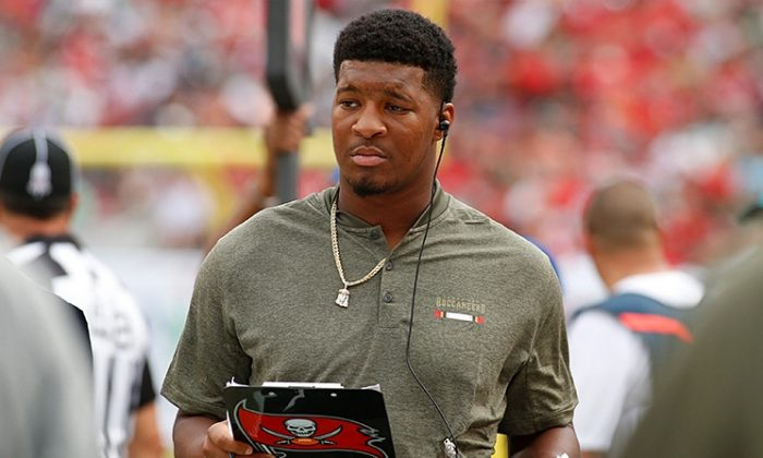 Quarterback Jameis Winston No. 3 of the Tampa Bay Buccaneers looks over his clipboard on the sidelines during an NFL football game against the New York Jets on Nov. 12, 2017. (Brian Blanco/Getty Images)