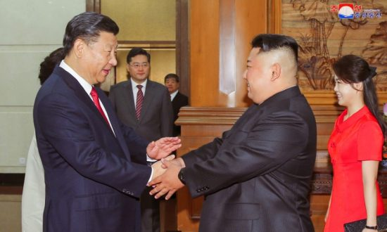 North Korea's Kim Reportedly Asked China During June Visit to Bring Early End to Sanctions