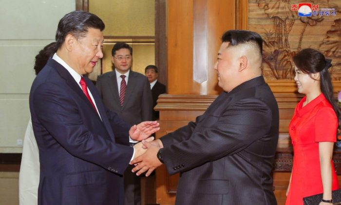 Chinese leader Xi Jinping shakes hands with North Korean leader Kim Jong Un in Beijing in this undated photo released by North Korea's Korean Central News Agency on June 20, 2018. (KCNA via Reuters)