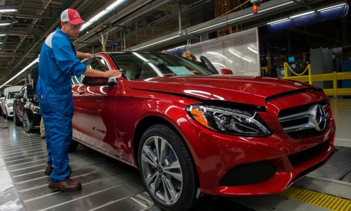 An employee does final inspections on a Mercedes-Benz C-Class at the Mercedes-Benz US International factory in Vance, Alabama on June 8, 2017. (ANDREW CABALLERO-REYNOLDS/AFP/Getty Images)