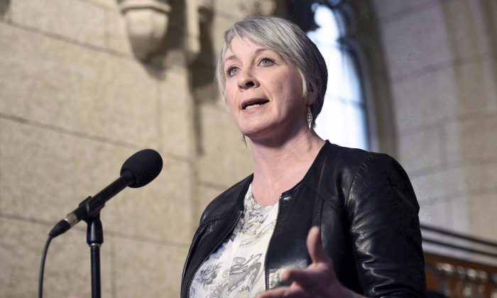 Employment Minister Patty Hajdu speaks to reporters on Parliament Hill on March 25, 2017. Sarnia Concrete is one of a group of companies that have banded together to launch legal challenges on purely business grounds to the controversial Canada Summer Jobs attestation requirement. (The Canadian Press/Justin Tang)