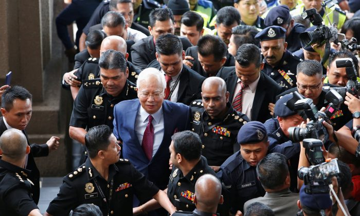 Former Malaysian prime minister Najib Razak arrives in court in Kuala Lumpur, Malaysia July 4, 2018. (Reuters/Lai Seng Sin)