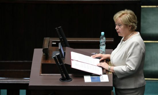 Polish Judge Defies Retirement Law, Protests Mount