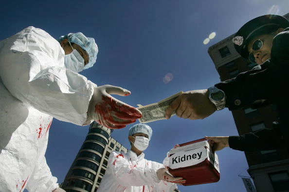 Chinese activists dramatize an illegal act of paying for human organs during a protest in Washington, D.C., on April 19, 2006 (Jim Watson/AFP/Getty Images)