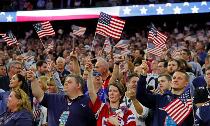 Fans wave American Flags during the National Anthem prior to Super Bowl 51 between the Atlanta Falcons and the New England Patriots at NRG Stadium in Houston, Texas, on Feb. 5, 2017. (Kevin C. Cox/Getty Images)