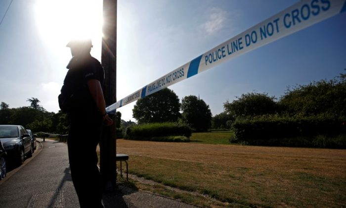 A police officer guards a cordoned off area after it was confirmed that two people had been poisoned with the nerve-agent Novichok, in Salisbury, Britain, July 5, 2018. (Henry Nicholls/Reuters)