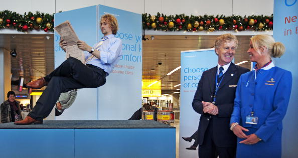 Dutch Illusionist Ramana shows (L) during a performance at Amsterdam Schiphol Airport the space for passengers of the new Economy Comfort class, on Dec. 7, 2009.  (Getty Images)