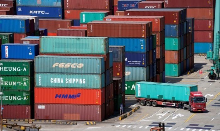 Shipping containers at the port in Shanghai, China, on April 10, 2018. REUTERS/Aly Song/File Photo