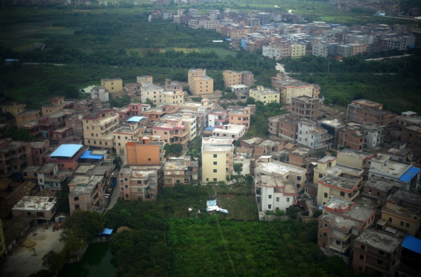 An aerial view of housing in the suburbs of Guangzhou, in southern China's Guangdong Province, on August 10, 2014. (Johannes Eisele/AFP/Getty Images)