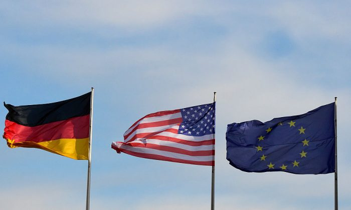 (L-R) The flags of Germany, the United States, and the European Union flutter at the Chancellery in Berlin, Germany on November 17, 2016. (Tobias Schwarz/AFP/Getty Images)